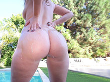Harley Jade showing off her amazing curves and big oiled ass